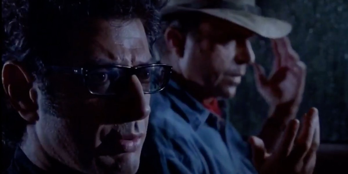 Jurassic Park Jeff Goldblum and Sam Neill riding in a stormy Jeep