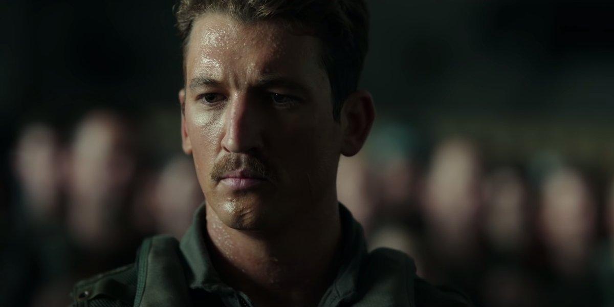 Top Gun: Maverick Miles Teller looking somber during a briefing