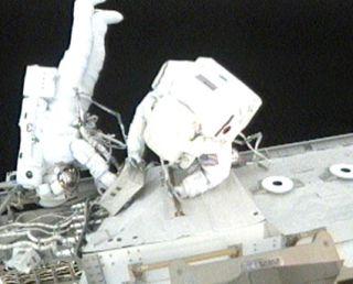 Astronauts Breeze Through Mission's First Spacewalk