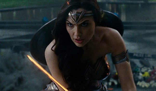 Justice League Wonder Woman stands in attack stance with her sword