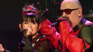 A still from the video of Babymetal and Rob Halford's performance at the Alternative Press Music awards