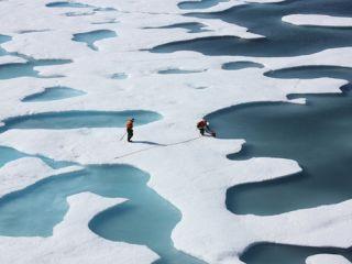 Melt waters atop Arctic sea ice