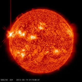 This image shows an X3.2 solar flare (far left) erupting from the sun late Monday (May 13, 2013) as seen by NASA's Solar Dynamics Observatory.