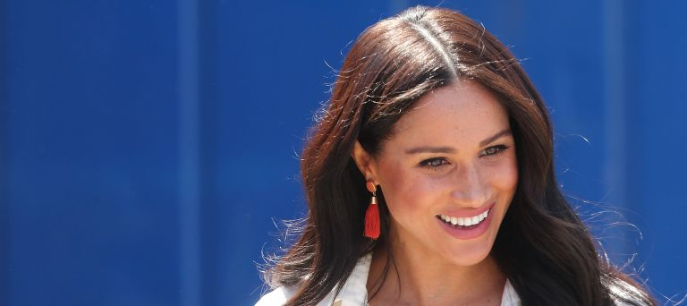Meghan Markle, Duchess of Sussex visits a township with Prince Harry, Duke of Sussex to learn about Youth Employment Service