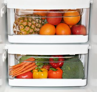 Fruits and veggies in clear drawers in the fridge