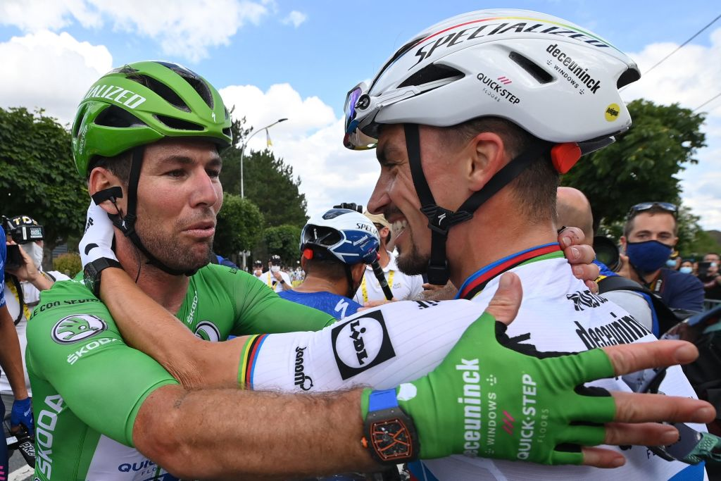 Team Deceuninck Quicksteps Mark Cavendish of Great Britain wearing the best sprinters green jersey L celebrates with Team Deceuninck Quicksteps Julian Alaphilippe of France after winning the 6th stage of the 108th edition of the Tour de France cycling race 160 km between Tours and Chateauroux on July 01 2021 Photo by POOL AFP Photo by POOLAFP via Getty Images
