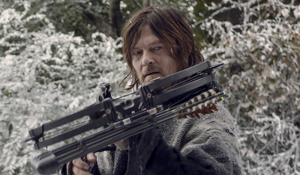 daryl with a crossbow in the snow