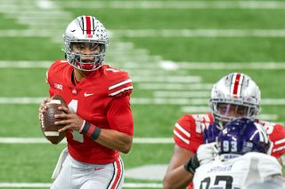 Ohio State Buckeyes quarterback Justin Fields looks up field during the Big Ten Championship against Northwestern on Dec. 19, 2020 at Lucas Oil Stadium in Indianapolis, Ind.
