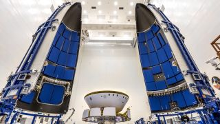 NASA's Mars 2020 Perseverance rover is prepared to be encapsulated in its Atlas V rocket payload fairing at NASA's Payload Hazardous Servicing Facility at the Kennedy Space Center in Florida on June 18, 2020.