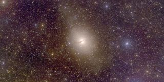 Galaxies Rotate in Sync, Raising Dark Matter Questions