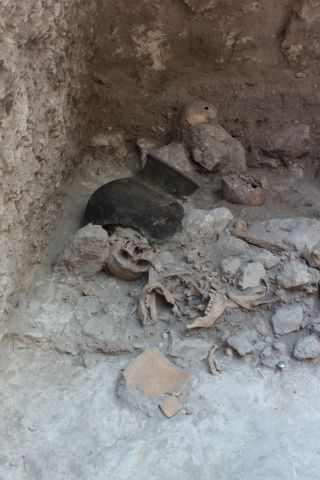 The remains of dismembered bodies in an artificial cave in the Classic Maya city Uxul in Mexico.