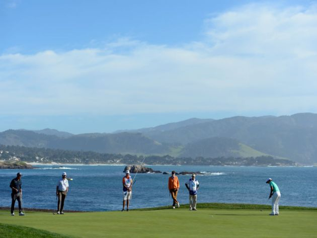 Breath-taking backdrop of Pebble Beach as Sung Kang of Korea putts on the 18th green