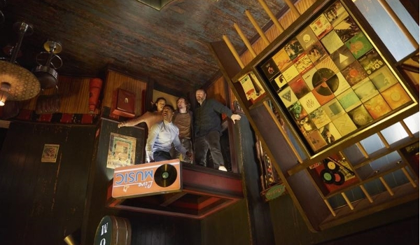 Escape Room four contestants in the upside down bar room