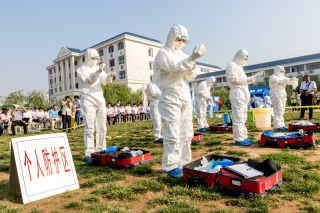 Health workers practice dealing with an outbreak of H7N9 avian flu on June 17, 2017, in Hebi, China.