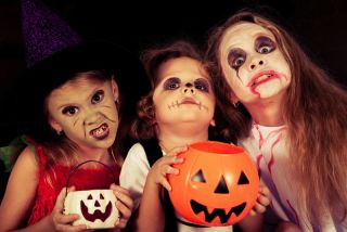Kids go trick-or-treating on Halloween.