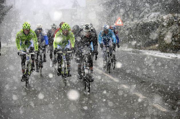 The peloton races through a snowstorm in the 2013 Milan San Remo