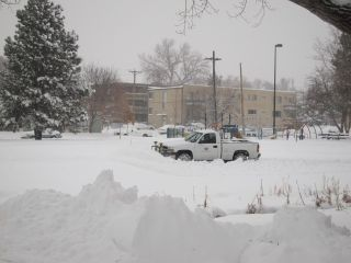 Snow day in Denver! A plow works in De Boer Park to clear snow from today's blizzard.