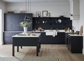 kitchen with dark cabinets and white worktops