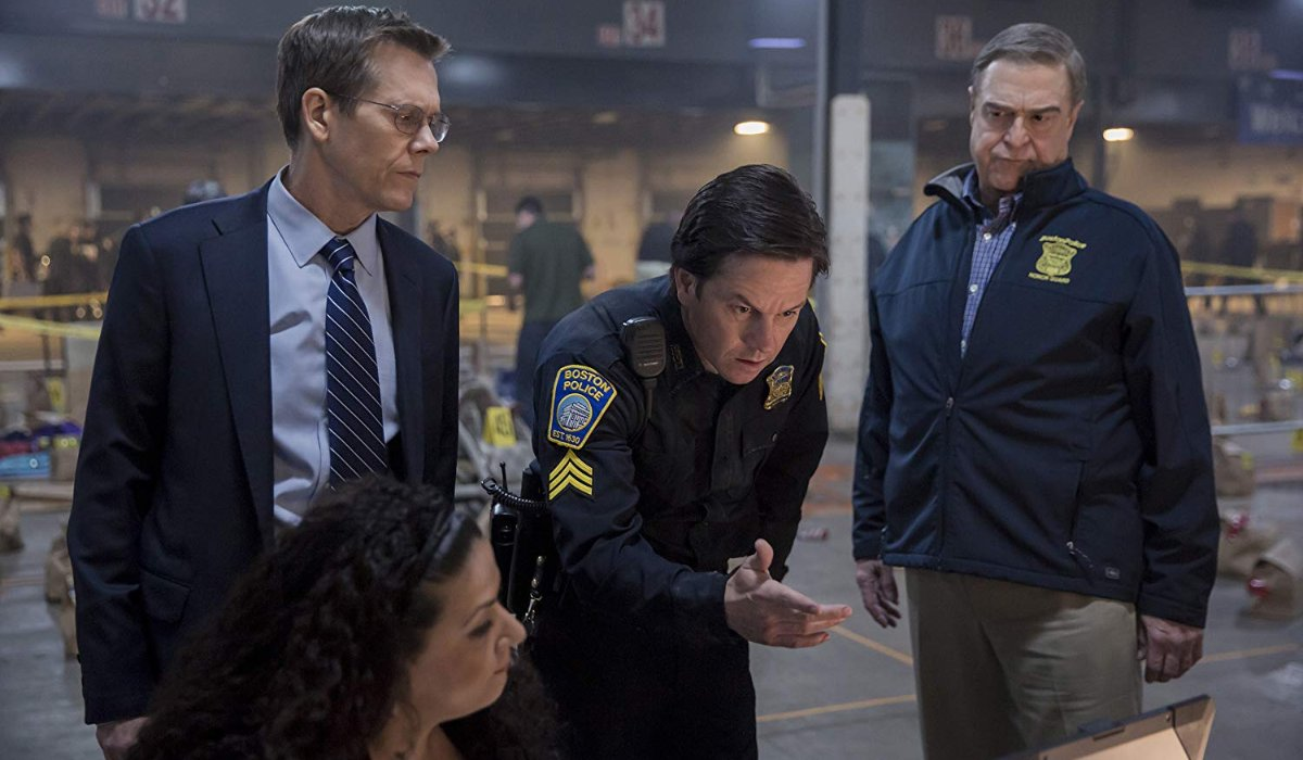 Patriots Day Kevin Bacon Mark Wahlberg and John Goodman look over evidence