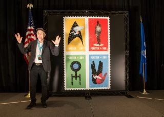 """Star Trek"" actor Walter Koenig (Pavel Chekov) gives the Vulcan salute with the U.S. Postal Service's new Trek stamps honoring the TV series' 50th anniversary."