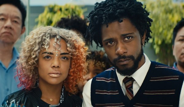 Sorry To Bother You Tessa Thompson Lakeith Stanfield staring at something displeasing