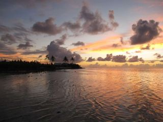 The sun sets on the beautiful atoll of Tarawa, which is being threatened by sea-level rise.