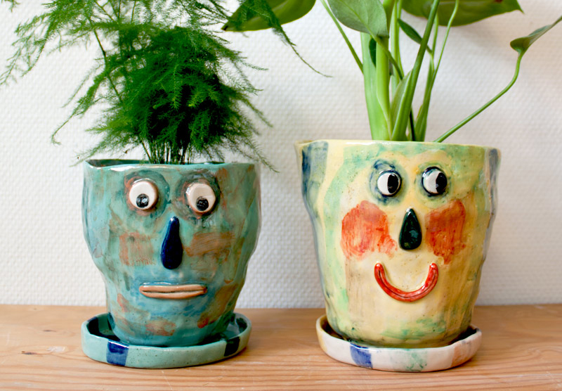 Ceramic plant pots with face by Karin Hagen