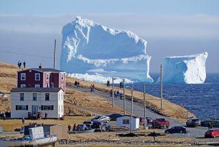 "A giant iceberg drifts by ""Iceberg Alley"" near Ferryland in Newfoundland, Canada."