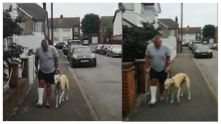 Russell walking with his dog, Bill, limping