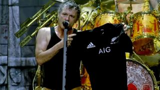 Bruce Dickinson onstage with his All Blacks jersey