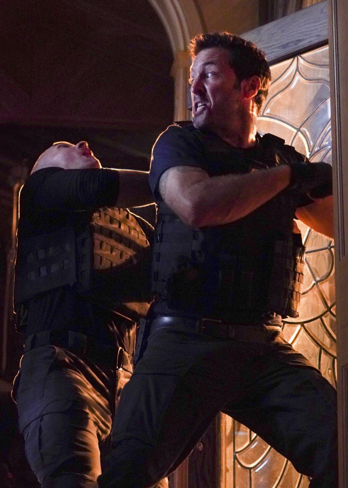 Steve McGarrett fights in doorway Hawaii Five-0 Season 10 Premiere CBS