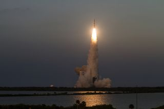 A United Launch Alliance Delta IV rocket launches the new Wideband Global SATCOM 7 satellite into orbit for the U.S. military on July 23, 2015 during an evening launch from the Cape Canaveral Air Force Station in Florida.
