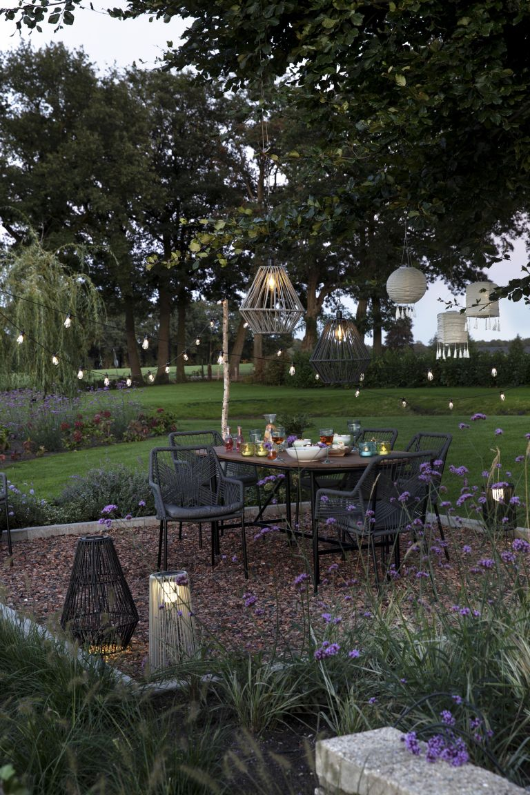 Festoon lighting illuminates a backyard