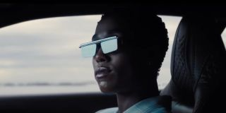 Lashana Lynch as Nomi making a cool entrance in her Jaguar during the final trailer for No Time to Die