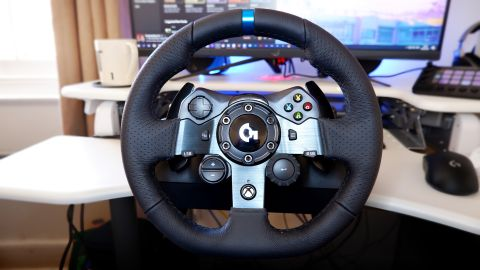 Logitech G923 racing wheel and pedals from various angles at a desk