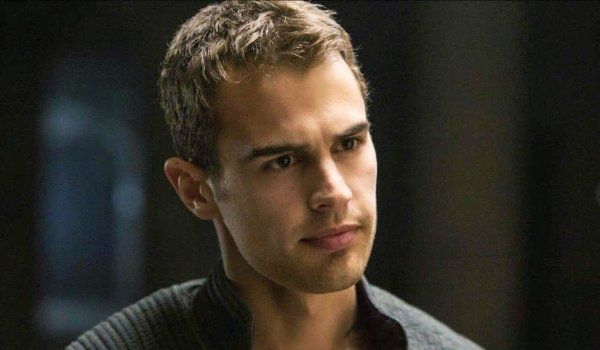 Theo James with a stern look on his face