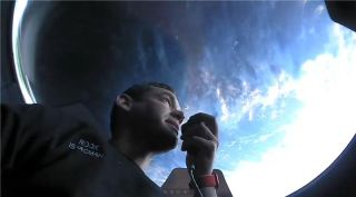 Inspiration4 commander and tech billionaire Jared Isaacman looks out the cupola window on SpaceX's Crew Dragon Resilience on Thursday, Sept. 16, 2021.