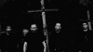 A press shot of Sunlight's Bane holding a crucifix