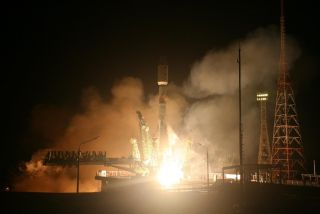 a Russian Soyuz carries the Egyptian Earth-observation satellite to orbit