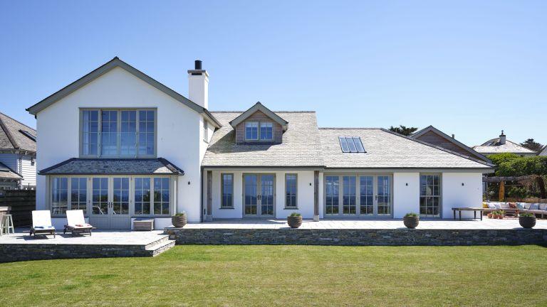 White exterior of Cornish coastal newbuild
