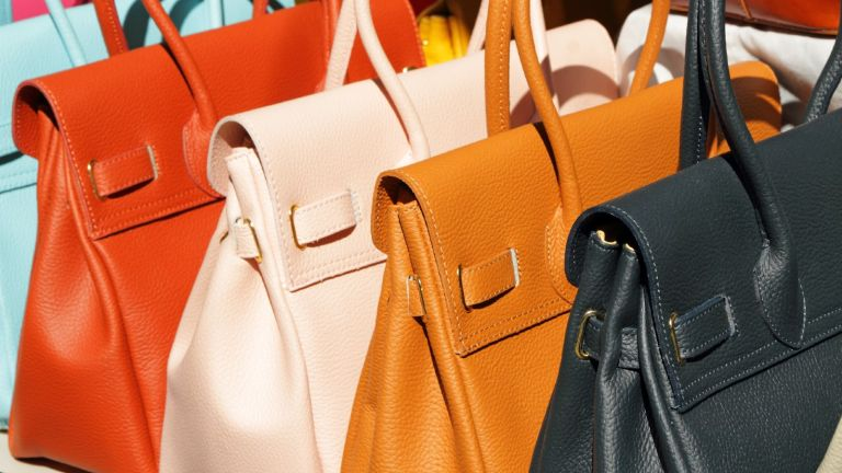 row of colourful designer bags