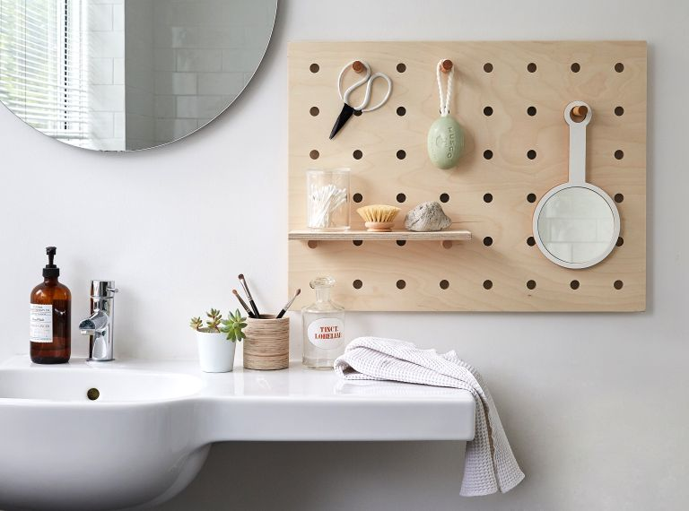 Cheap bathroom ideas: Peg board storage in a white bathroom