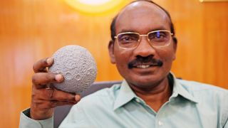 K. Sivan, head of the India Space Research Organisation, holds a lunar model on Aug. 26, 2019, as the country's Chandrayaan-2 spacecraft flew toward the moon.