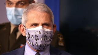 Dr. Anthony Fauci, director of the National Institute of Allergy and Infectious Diseases, wears two protective face masks during a White House Coronavirus Task Force press briefing