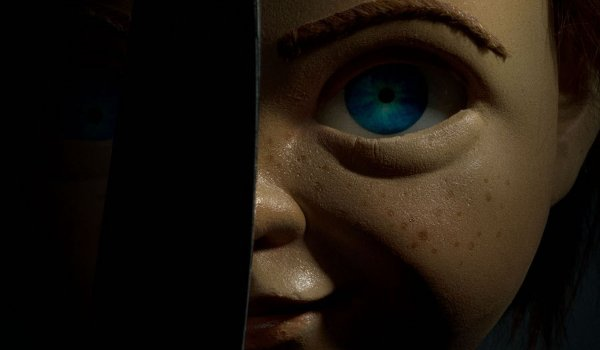 Child's Play (2019) Chucky's face partially obscured by a knife