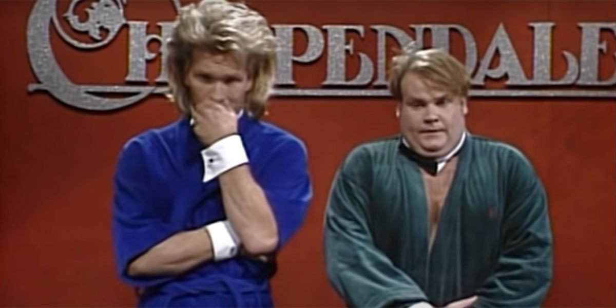 Chris Farley and Patrick Swayze standing on stage in robes during an SNL sketch about Chippendale's.