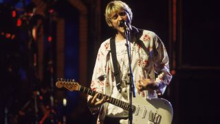 Kurt Cobain (1967-1994) performs on stage with Nirvana at the MTV Video Music Awards, September 10, 1992.