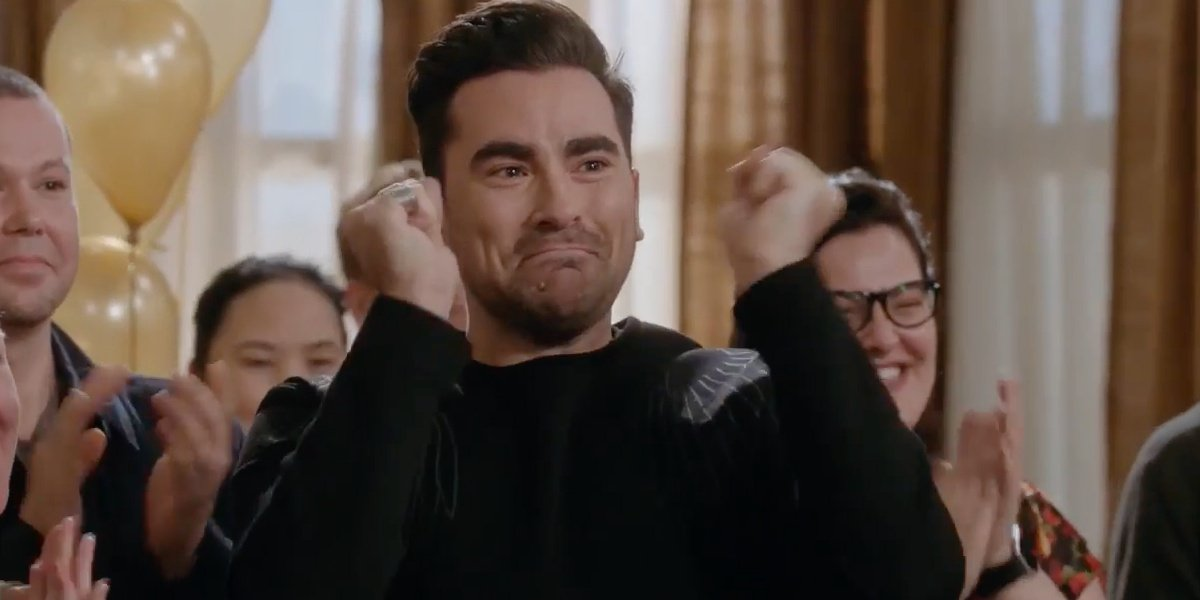 David cheering on Alexis and Ted in Schitt's Creek.