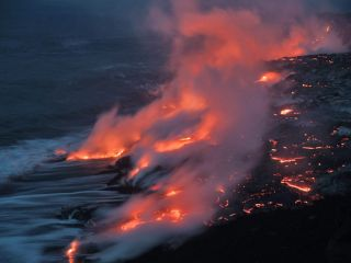 Lava from a 2004 eruption at Mt. Kilauea flows into the ocean. Lava emits toxic gases, and, when combined with seawater, it can form mists of corrosive hydrochloric acid.
