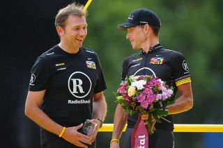 Johan Bruyneel (left) with Lance Armstrong at the 2010 Tour de France